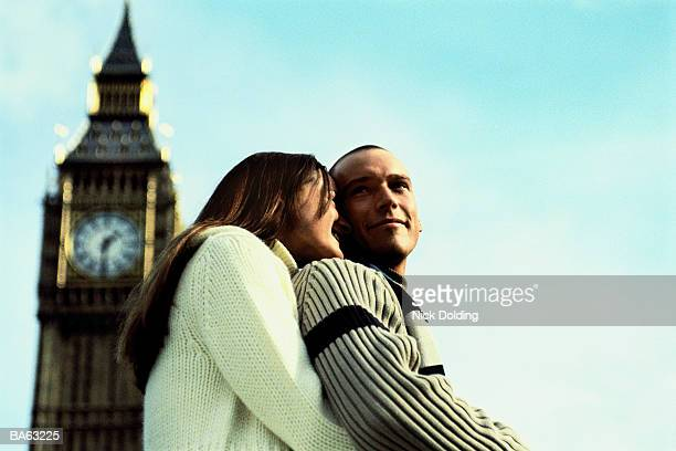 England, London, Big Ben, focus on couple embracing in foreground