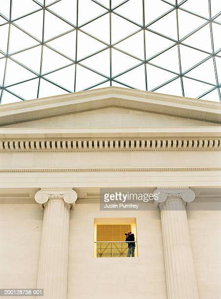 england, london, british museum, man taking photograph, low angle view - column stock pictures, royalty-free photos & images