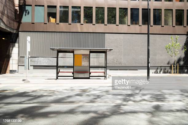 uk, england, london, bus stop on empty street - sparse stock pictures, royalty-free photos & images