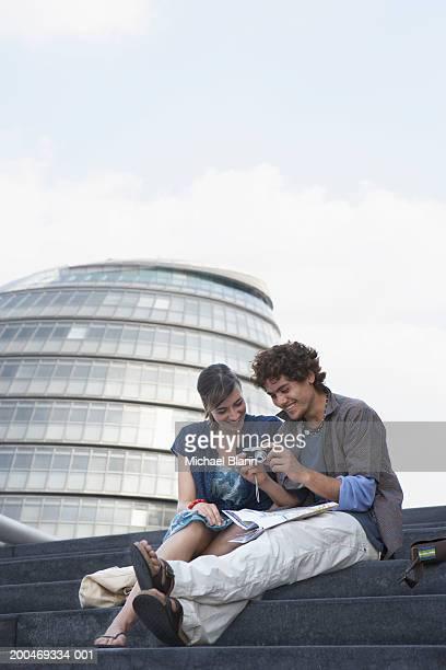 England, London, City Hall, couple sitting on steps