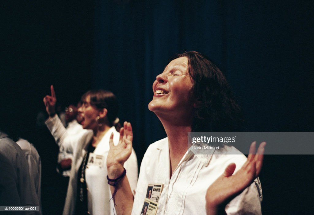Woman praying during religious event