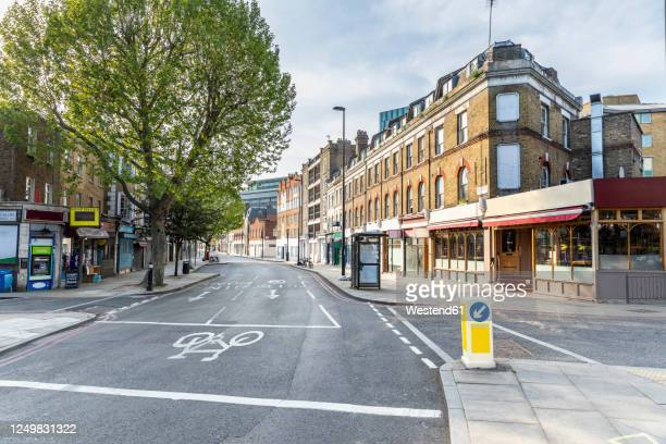 uk, england, london, empty city street during covid-19 pandemic - sparse stock pictures, royalty-free photos & images