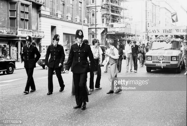 England, London, Gay Pride Parade, Piccadilly, Metropolitan Police escort, Ford Transit carnival float.