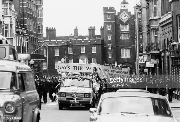 England, London, Gay Pride Parade, St James St, Ford Transit series 2 pickup carnival float, Metropolitan Police, Met control Ford Transit.