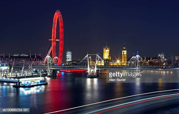 england, london, hungerford bridge and millennium wheel at night - 2007 stock pictures, royalty-free photos & images
