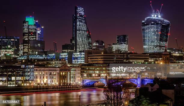 UK, England, London, Illuminated riverfront skyline with skyscrapers
