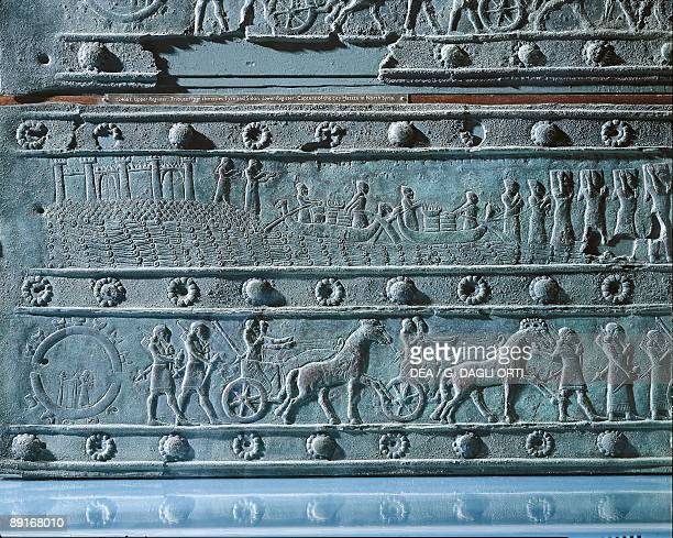 England London Mesopotamian Art Bronze panel door showing Assyrians offering tributes to the Phoenician King of Tyre and Sidon below the storming of...