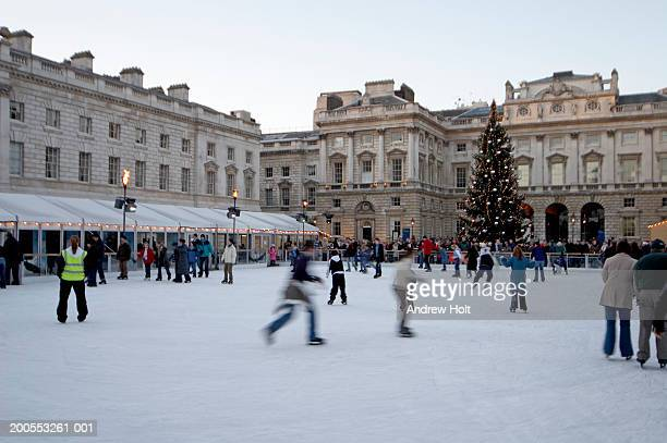england, london, people ice skating on rink at somerset house - ice rink stock pictures, royalty-free photos & images