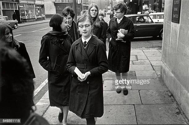 England London pupils girls dressed in school uniform on their way home from school on Clapham Road