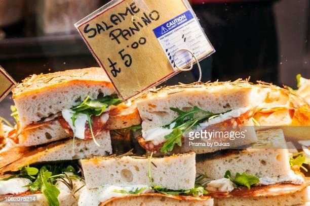 England London Southwark Borough Market Food Stall Display of Salami Panino Sandwiches