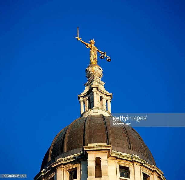 england, london, statue of justice on dome of the old bailey - old bailey stock photos and pictures