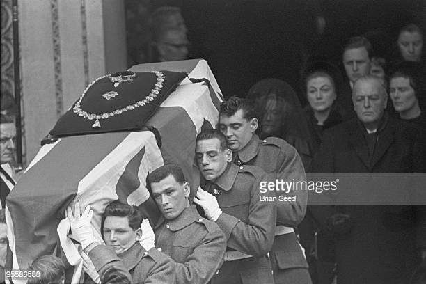 England, London, St.Paul's Cathedral, guardsmen carry the draped coffin of Sir WInston Churchill down the steep steps of the cathedral. In the...