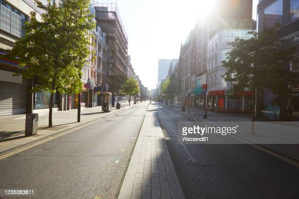 uk, england, london, sun shining over emptyoxford street - no people stock pictures, royalty-free photos & images