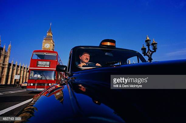 England, London, taxi on Westminster Bridge (wide angle)