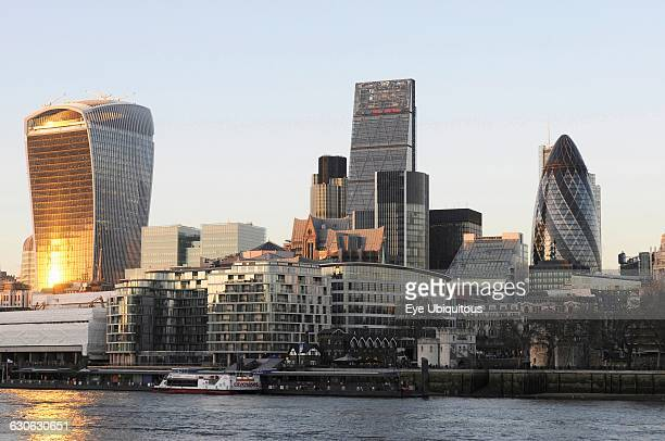 England London The Modern skyline of the City with The Walkie Talkie Building The Gherkin The Cheesegrater at sundown and the River Thames