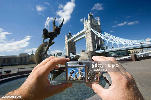 England, London, Tower Bridge, man taking photograph, (composite)