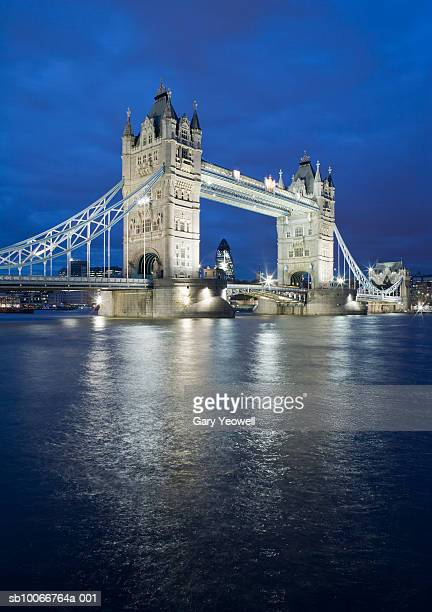 england, london, tower bridge over river thames at dusk - yeowell stock photos and pictures