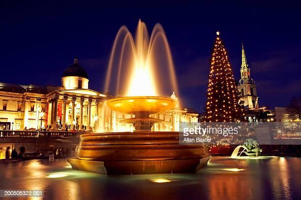 England, London, Trafalger Square fountain, night