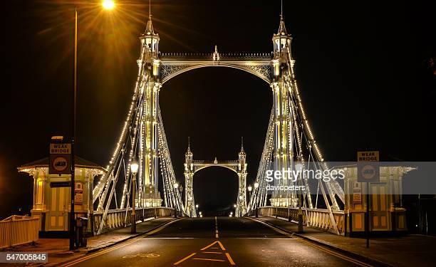 UK, England, London, View along illuminated Albert Bridge