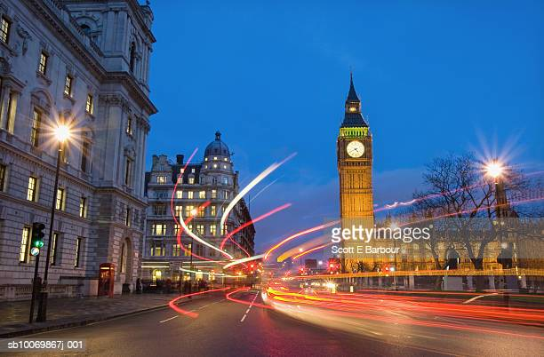 england, london, westminster, big ben and houses of parliament at dusk with blurred traffic - parliament square stock pictures, royalty-free photos & images