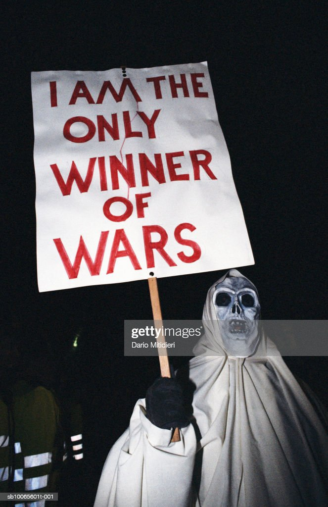 Protestor in costume with placard : News Photo