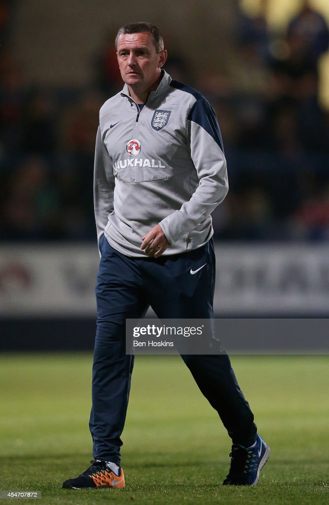 England manager Aidy Boothroyd looks on during the U20 International friendly match between England and Romania on September 5, 2014 in Telford, England.