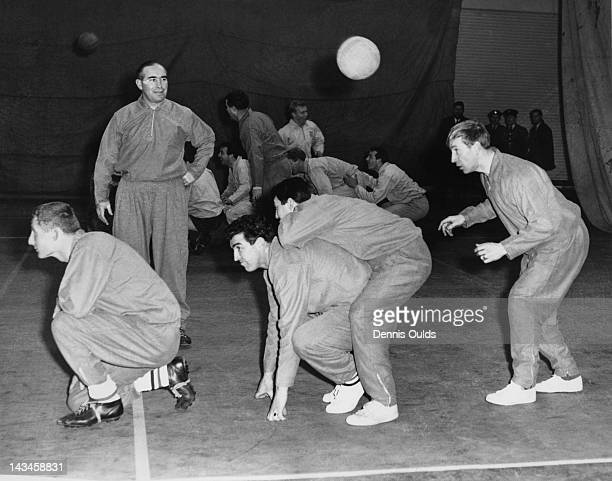 England manager Alf Ramsey during a training session with the national team at Stanmore RAF station, 13th February 1963. Player Bobby Charlton is...