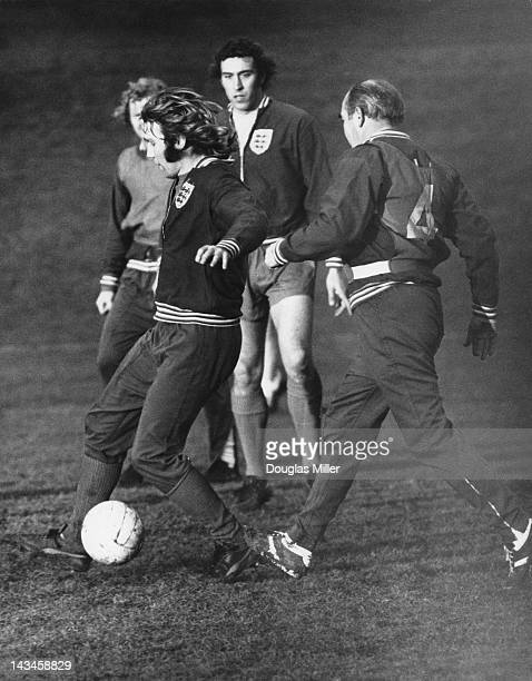 England manager Alf Ramsey tackles Tony Currie during a training session at Stevenage Hertfordshire before a match against Wales 22nd January 1973 In...