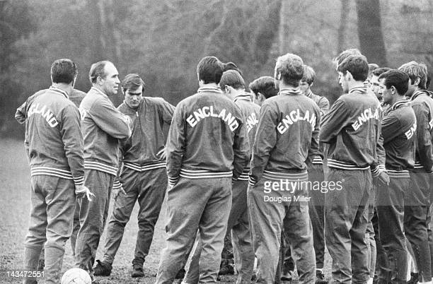 England manager Alf Ramsey talks to players during a training session at Roehampton London 11th March 1969 The team is preparing for a match against...