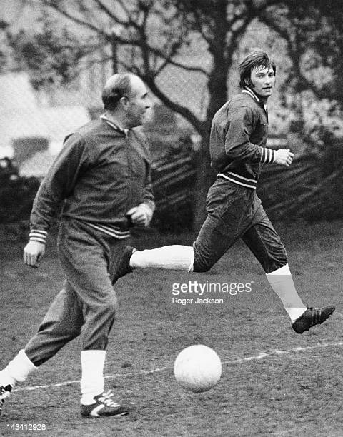 England manager Alf Ramsey with England player Colin Todd during a training session at Roehampton London 1st April 1974 The team is preparing for a...