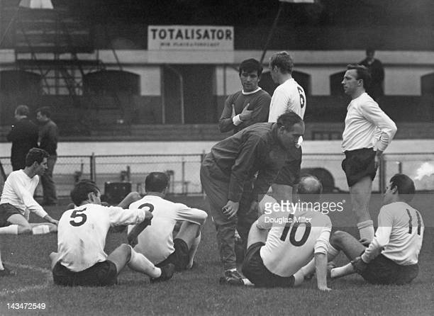 England manager Alf Ramsey with members of the national team during a practice game against Chelsea at Stamford Bridge London 19th September 1965