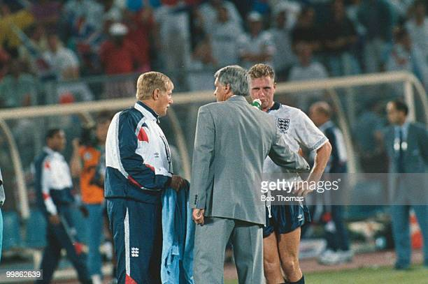 England manager Bobby Robson and doctor John Crane console Paul Gasgoigne during the 1990 World Cup finals in Turin 4th July 1990 West Germany beat...