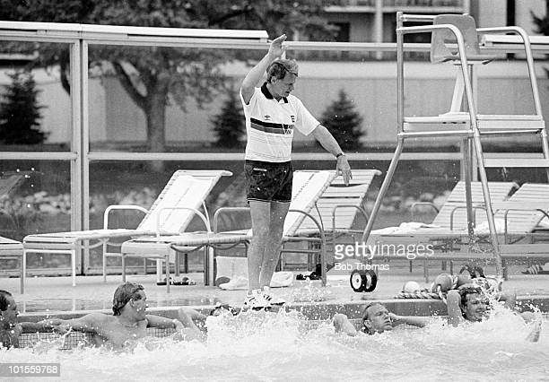 England manager Bobby Robson giving directions to players in the hotel swimming pool at The Broadmoor Hotel in Colorado Springs Colorado USA on 145h...