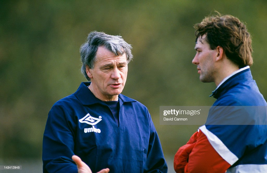 England manager Bobby Robson (1933 - 2009, left) with player Bryan Robson at an England training session, circa 1985.