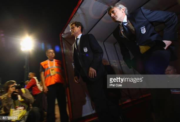 England Manager Fabio Capello and Assistant Franco Baldini walk out on to the pitch prior to the FIFA 2010 World Cup Qualifying Group Six match...