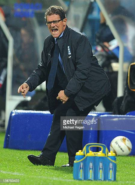 England manager Fabio Capello gestures during the UEFA EURO 2012 group G qualifier match between Montenegro and England at the Gradski Stadium on...