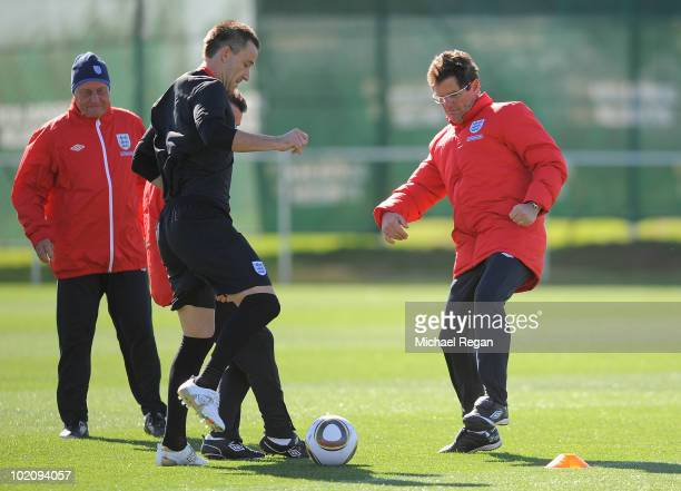England manager Fabio Capello goes for the ball with John Terry during the England training session at the Royal Bafokeng Stadium on June 15, 2010 in...