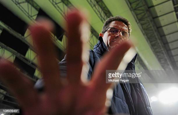 England manager Fabio Capello looks on before the international friendly match between Denmark and England at Parken Stadium on February 9, 2011 in...