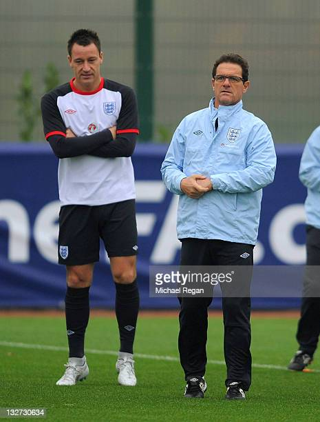 England manager Fabio Capello looks on with John Terry during the England training session on November 14 2011 in London Colney England