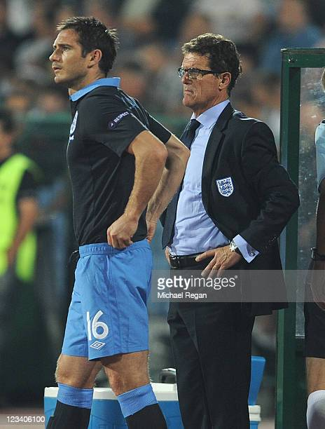 England manager Fabio Capello looks on with sub Frank Lampard during the EURO 2012 group G qualifying match between Bulgaria and England at the Vasil...
