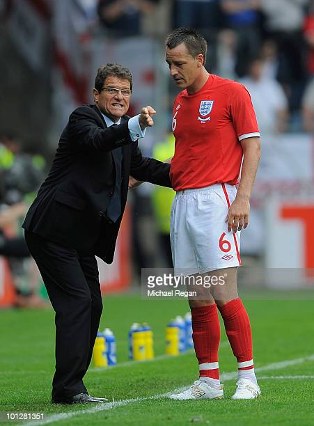 England manager Fabio Capello talks to John Terry during the International Friendly match between Japan and England at the UPCArena on May 30 2010 in...