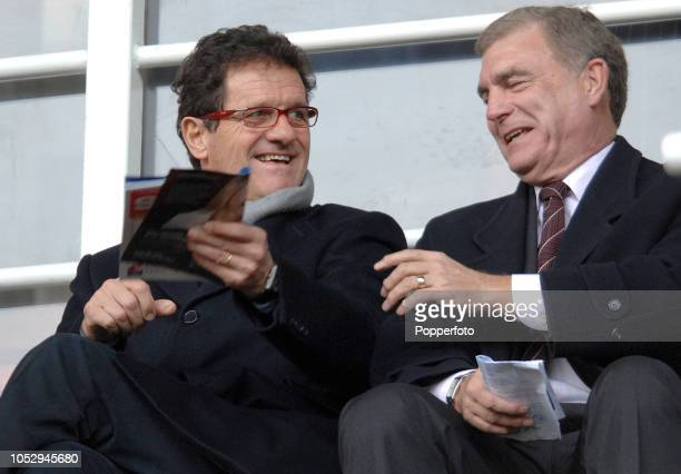 England manager Fabio Capello talks with The FA's Director of Football Development Sir Trevor Brooking prior to the Barclays Premier League match...