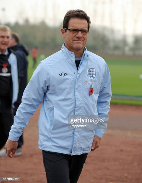 England Manager Fabio Capello walks out to an England Training Session at Arsenal's training facility at Colney London on November 10 2011