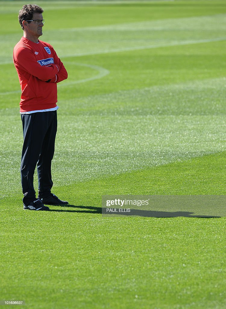 England Manager Fabio Capello watches as his players take part in a training session at the Royal Bafokeng Sports Campus near Rustenburg on June 5, 2010.