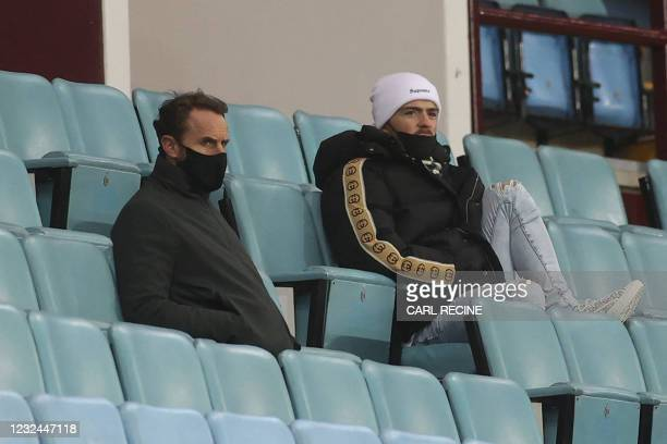 England manager Gareth Southgate and Aston Villa's English midfielder Jack Grealish watch from the stands during the English Premier League football...