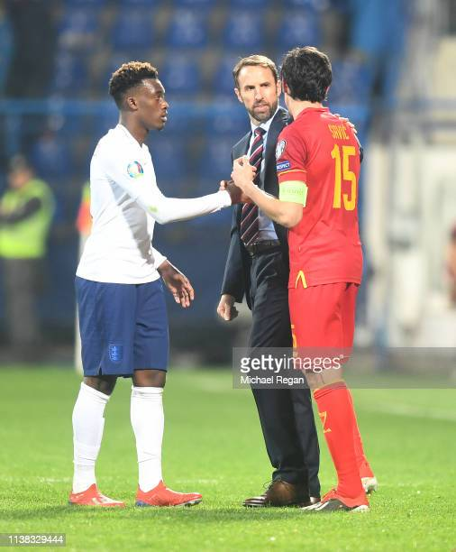 England manager Gareth Southgate and Callum HudsonOdoi of England speak to Stefan Savic of Montenegro after the 2020 UEFA European Championships...