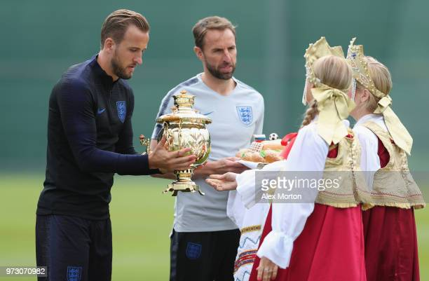 England manager Gareth Southgate and captain Harry Kane are presented with giftsduring a training session as part of the England media access at...