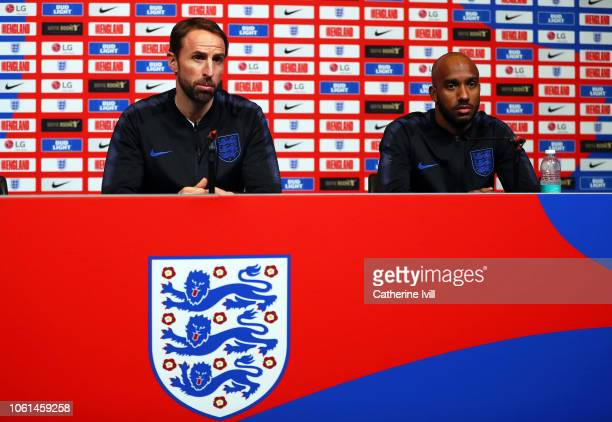 England Manager Gareth Southgate and Fabian Delph speak during an England press conference at Wembley Stadium on November 14 2018 in London England