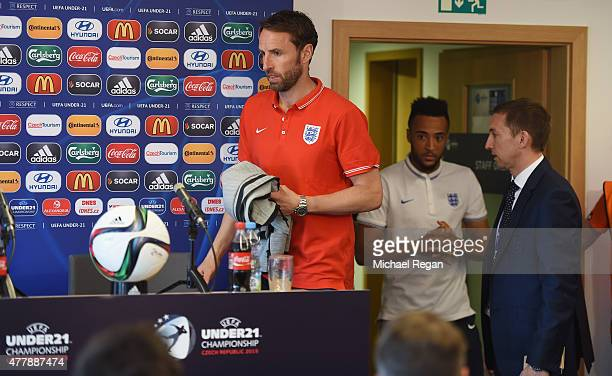 England manager Gareth Southgate looks on with Nathan Redmond as they speak to the press during the England U21 training session and press conference...