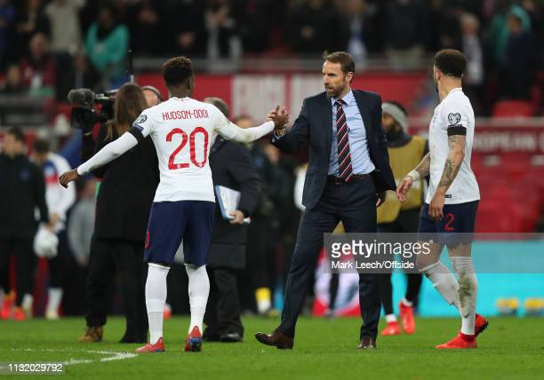 England manager Gareth Southgate shakes the hand of Callum Hudson-Odoi of England after the 2020 UEFA European Championships qualifying match between...